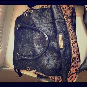 Gently used Steve Madden leopard bag